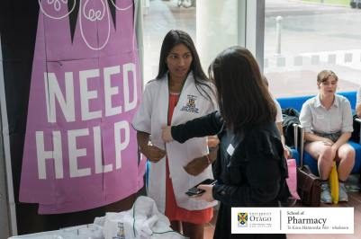 A P2 student receiving her white coat